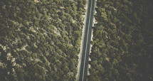 aerial view over a forest and highway