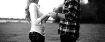 Young couple holding hands looking at each other