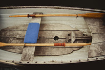 Wooden canoe and paddles