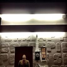 Asian man looking up at a door frame