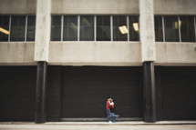 couple hugging in front of building