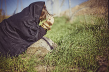 persecuted woman with arms tided and covered in a blanket