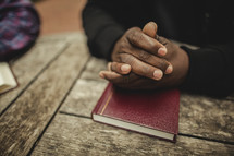 Man  in prayer with bible