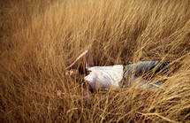 A woman lying in a field