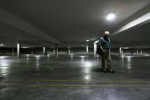 Man in empty parking garage