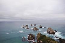 rocks in the ocean along a shore