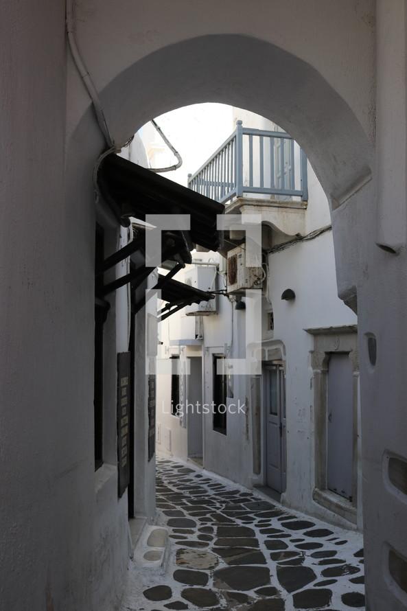 stone walkway between buildings