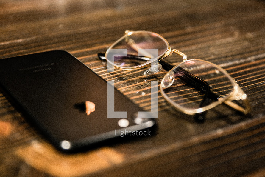 cellphone and reading glasses