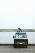a couple standing with a VW van