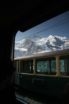 cable car and snowy mountain peaks