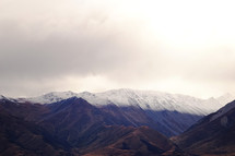 dusting of snow on mountain peaks
