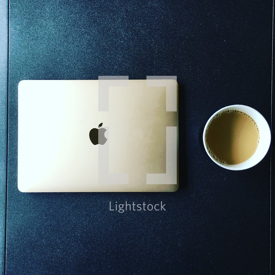 MacBook and coffee cup