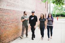 friends walking down a sidewalk talking