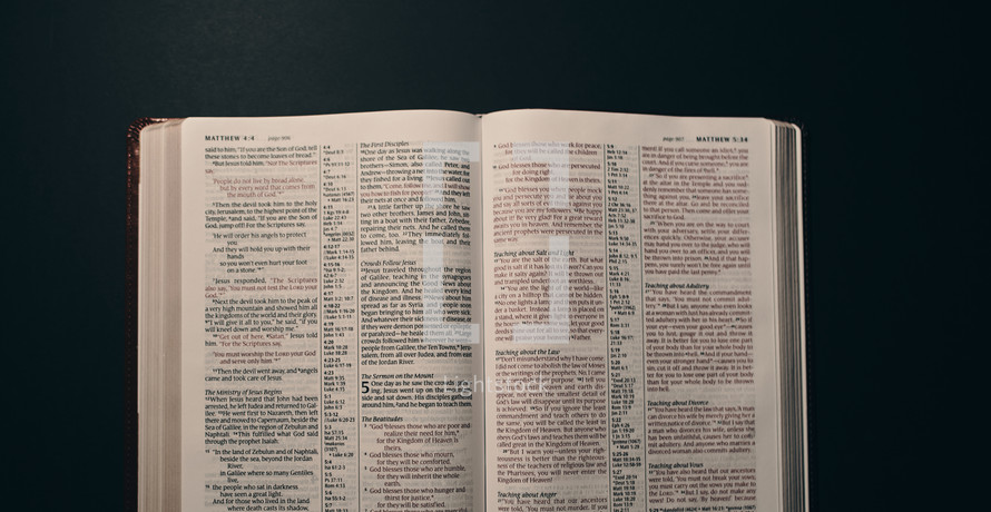 pages of an opened Bible turned to Matthew