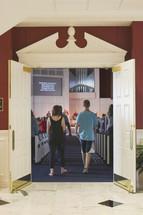 entering through doors into a church