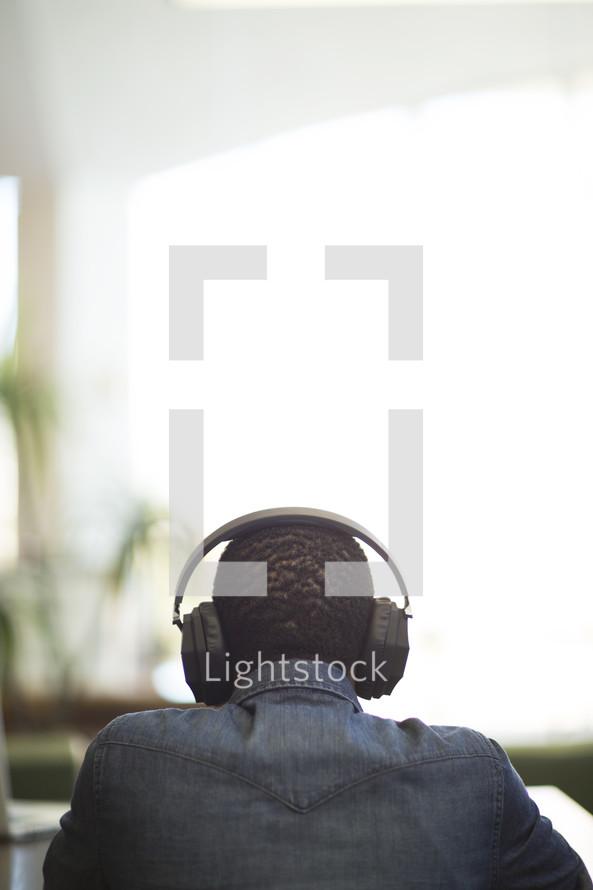 a man listening to headphones.