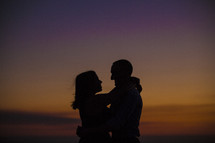 silhouette of a couple holding each other