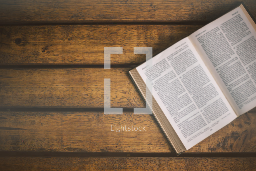 open Bible on a wooden table