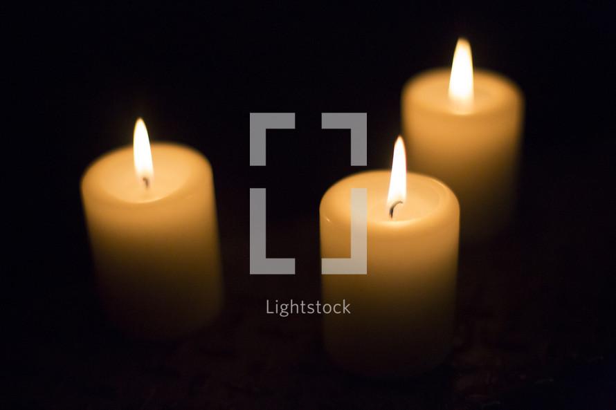 three candles burning