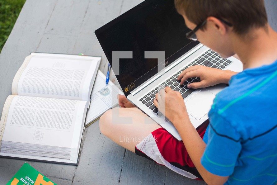 a child doing schoolwork outdoors