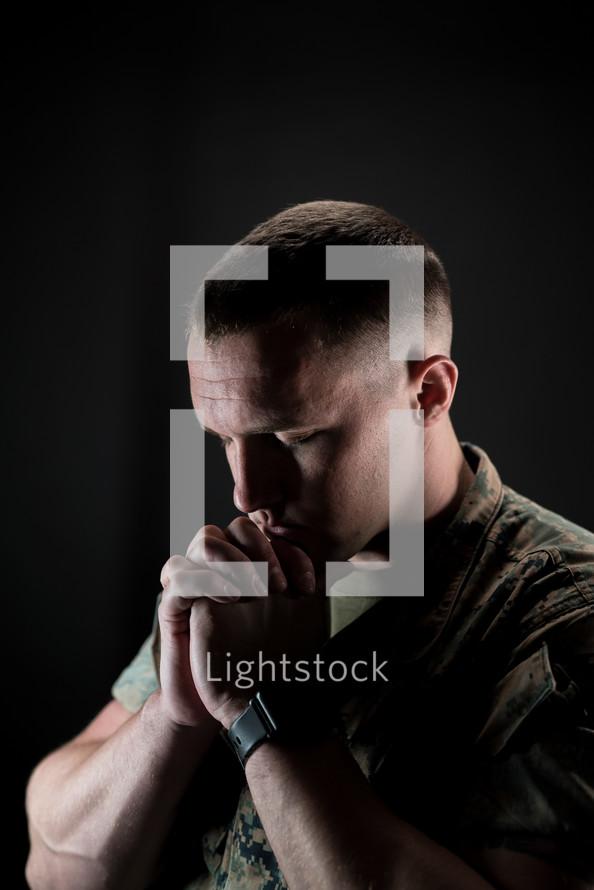 a serviceman praying