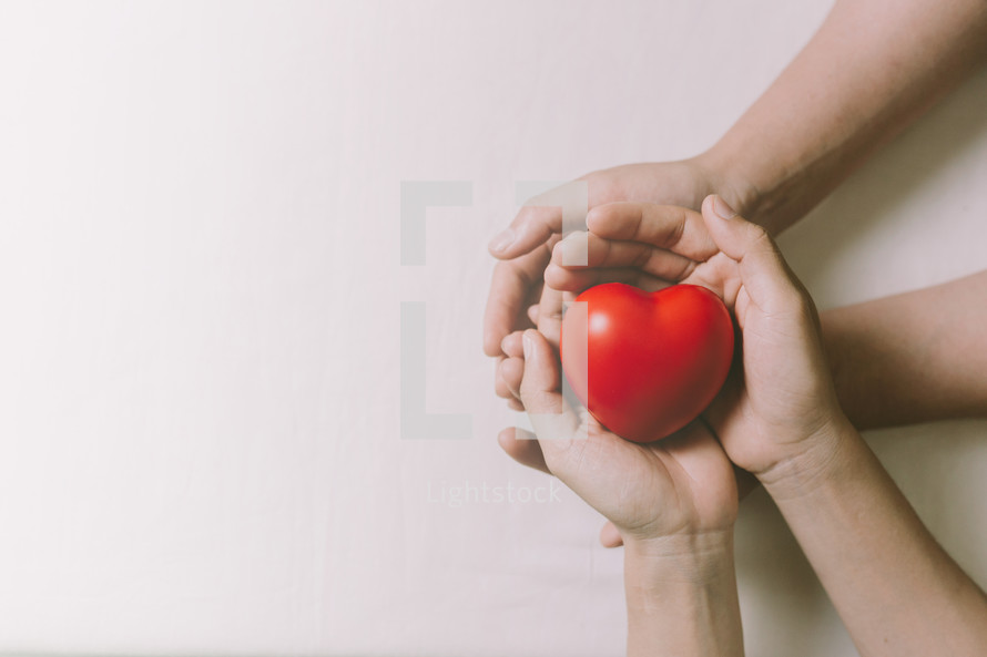 red heart in cupped hands