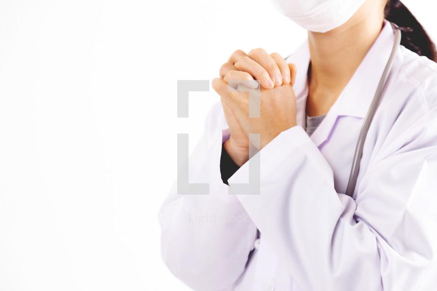 a doctor praying