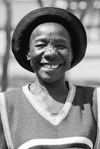 Smiling man wearing a hat .
