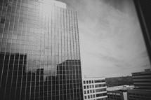 A tall skyscraper from a window