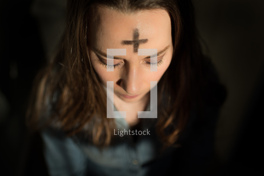 cross of ashes on a forehead