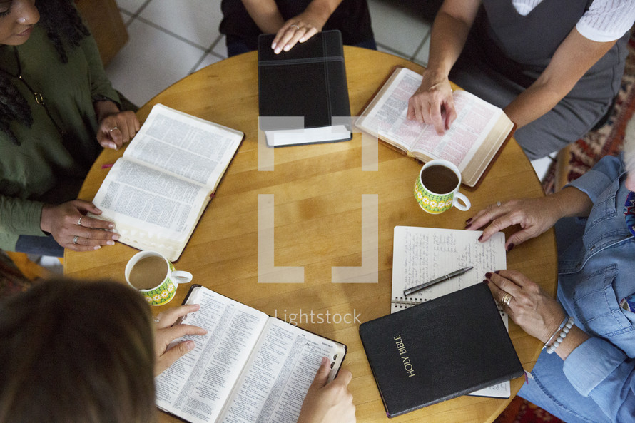 woman's group Bible study having a discussion around a table
