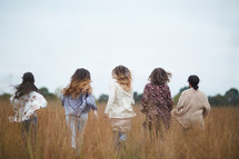 group of women walking through a field