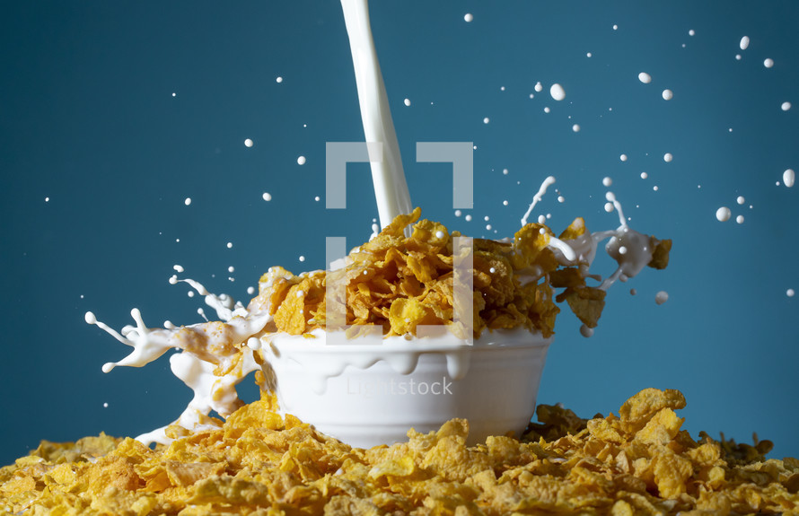 A Bowl of MIlk Being Poured and Splashing Out