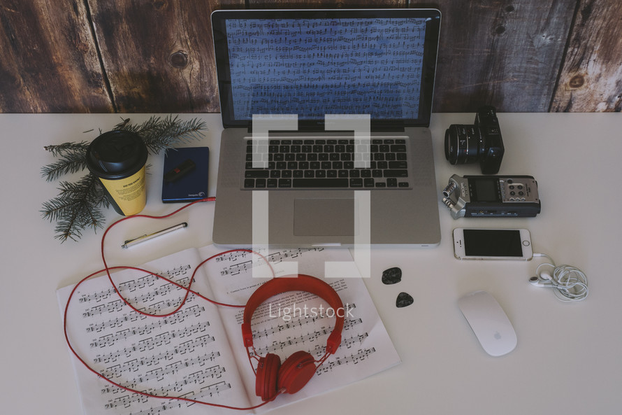 laptop, headphones, sheet music, pine boughs, mouse, laptop, iPhone, earbuds, blog, camera, lens, photography, photo editing, coffee cup, desk