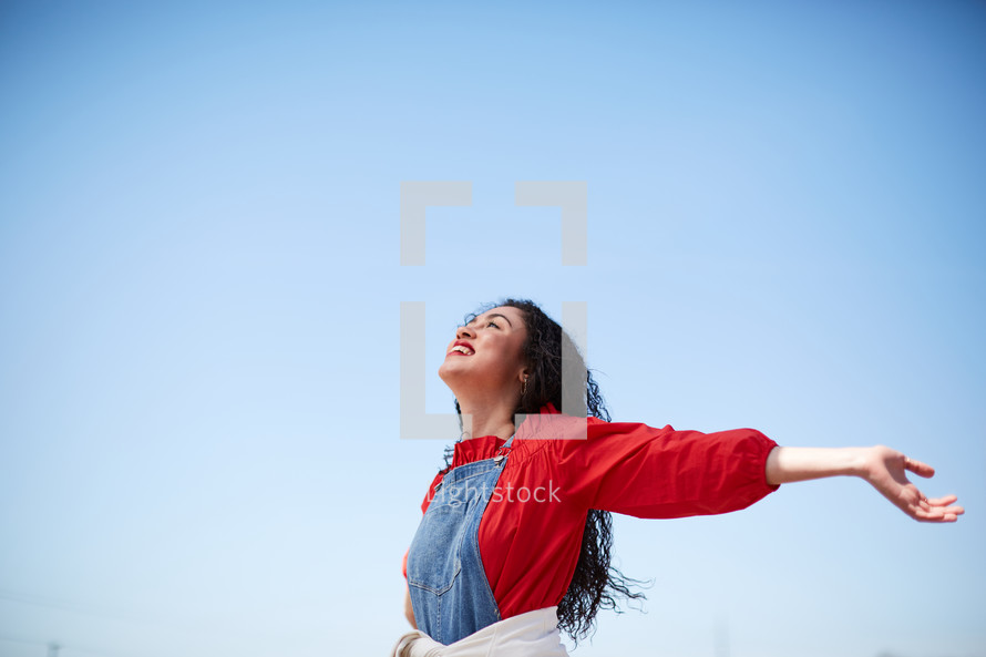 a woman with outstretched arms