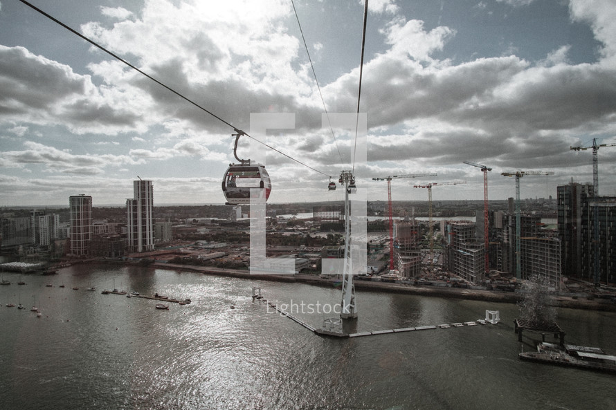 building cranes and sky cable cars in London