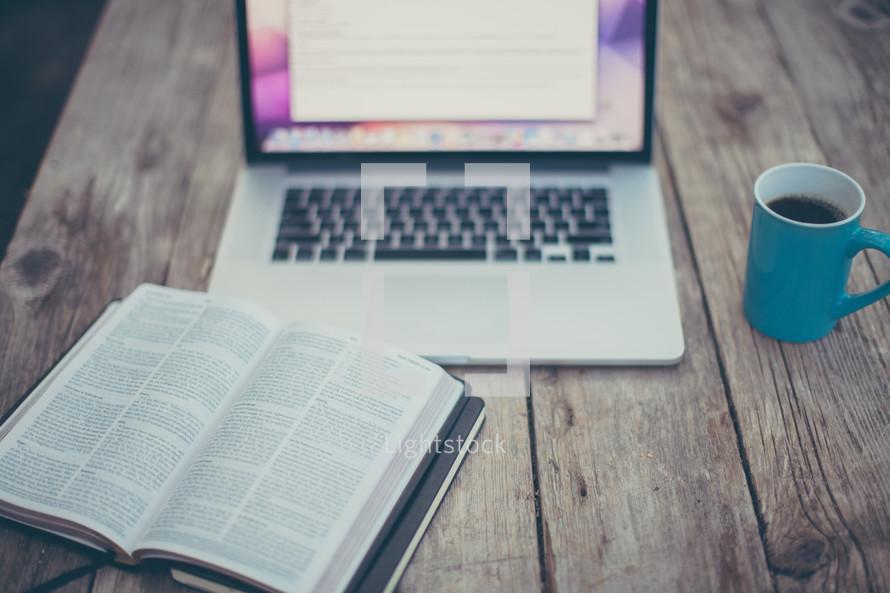 computer screen, open Bible, coffee mug