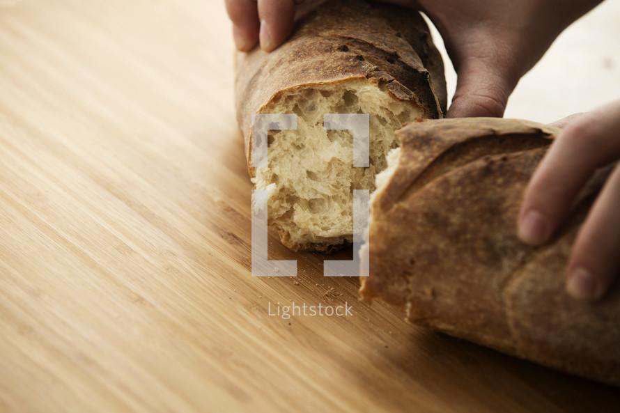 A woman breaking bread