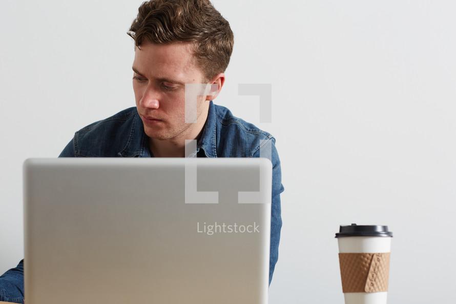 a man sitting behind a computer