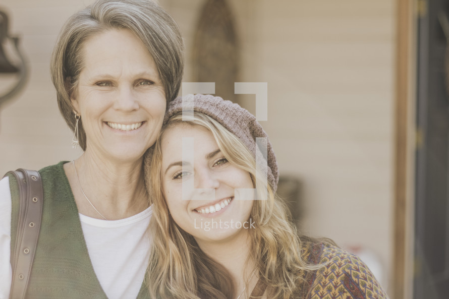 Mother and college aged daughter.