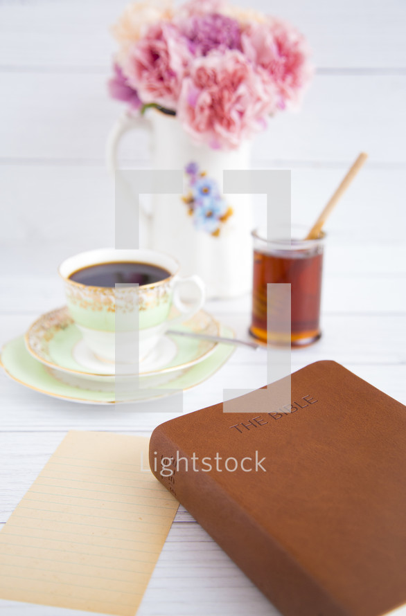 tea, muffins, and Bible on a table