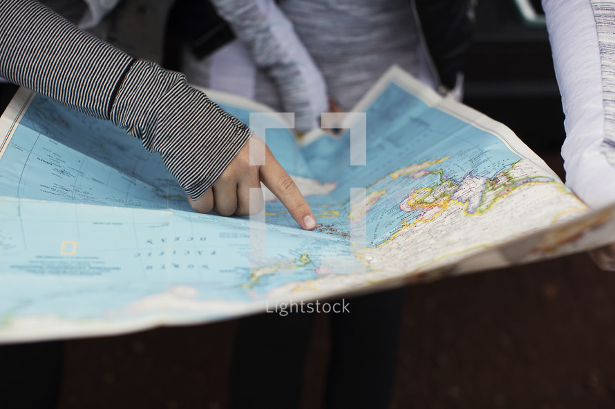 Two women looking at a map.