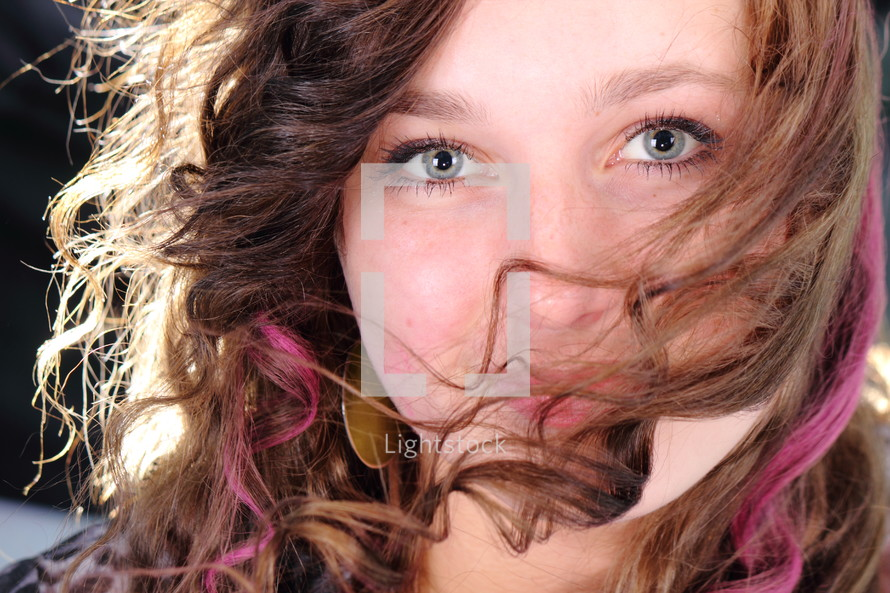 hair covering a woman's face