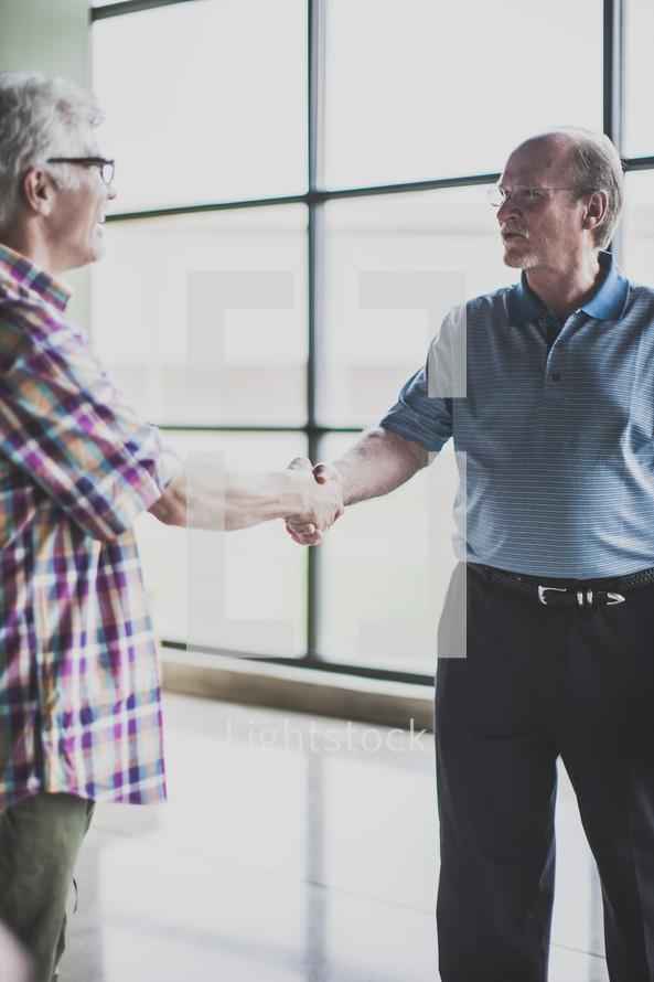 welcoming handshakes