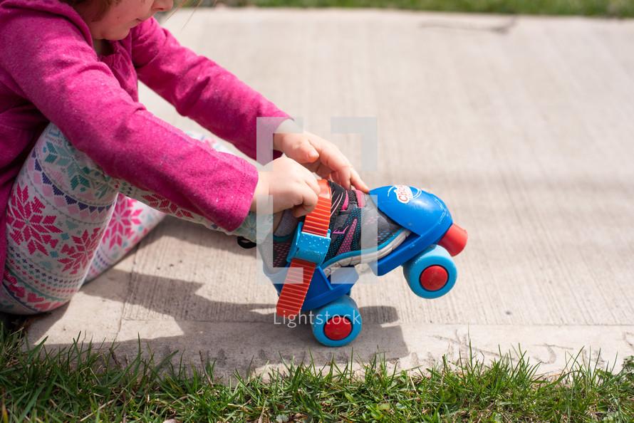 a child putting on roller skates
