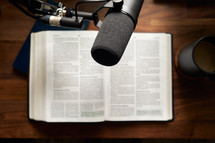 microphone over the pages of an opened Bible