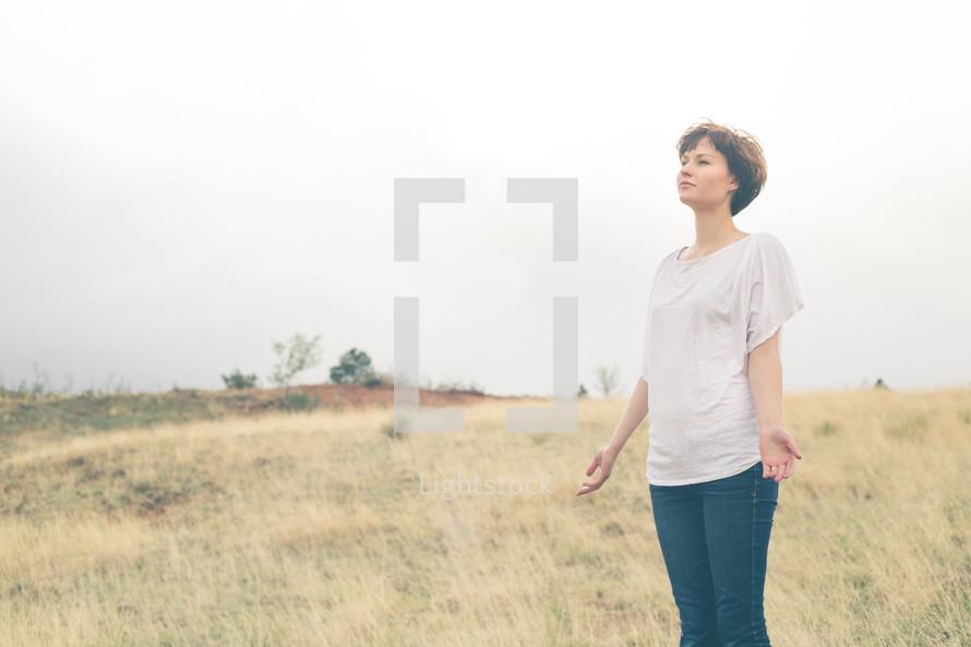 Woman worshiping outside.