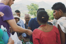 missionary passing out supplies