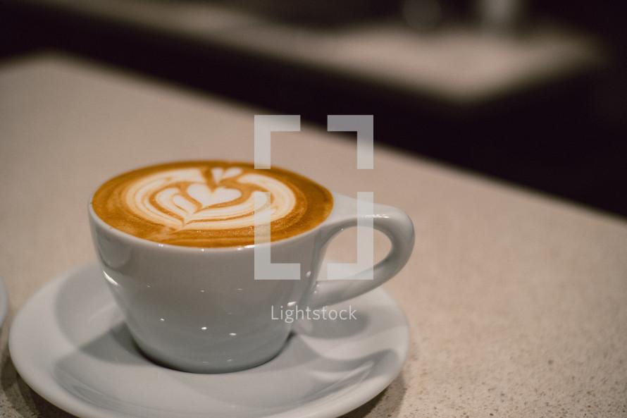 creamer heart design in coffee cup