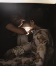 children touching a nightlight